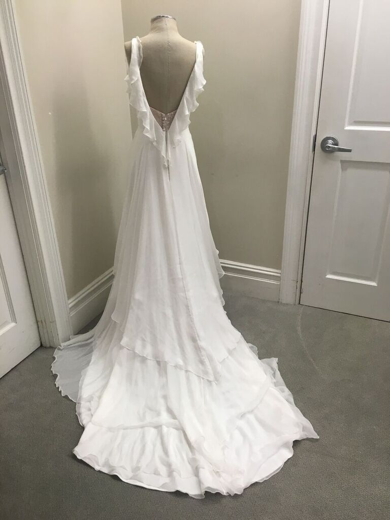 This Mark Zunino dress from @kleinfeld has just the right amount of personality. With cascading ruffles and a low-back, this dress will make a statement on any bride.