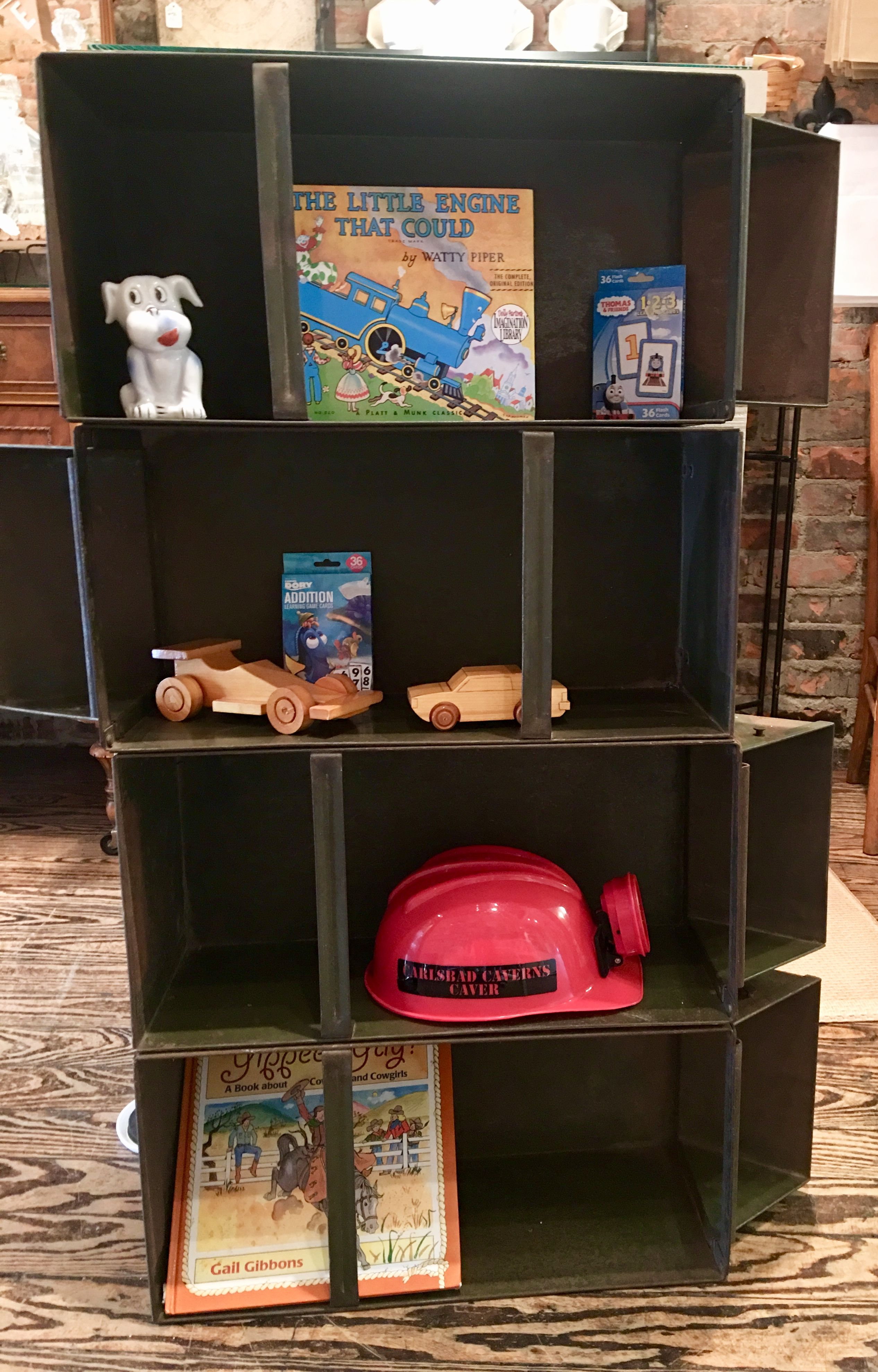 Here is perfect example of upcycling.  Old auto part bins were assembled to create this unique bookcase.  Stop in the shop and see us!  🇺🇸 Memorial Weekend Hours: 🇺🇸  Friday: 11am-3pm  Saturday, Sunday and Monday: Closed  #upcycle #upcycling #upcyclingproject #upcyclingideas #upcyclinglife #shoplocalmacomb #shoplocal #makemacombyourhome #downtownromeo #shopdowntownromeo #romeomichigan #locallove #uniquehomedecor #bookcaseideas #bookcase #bookshelves #shelvingideas #metrodetroitmommy