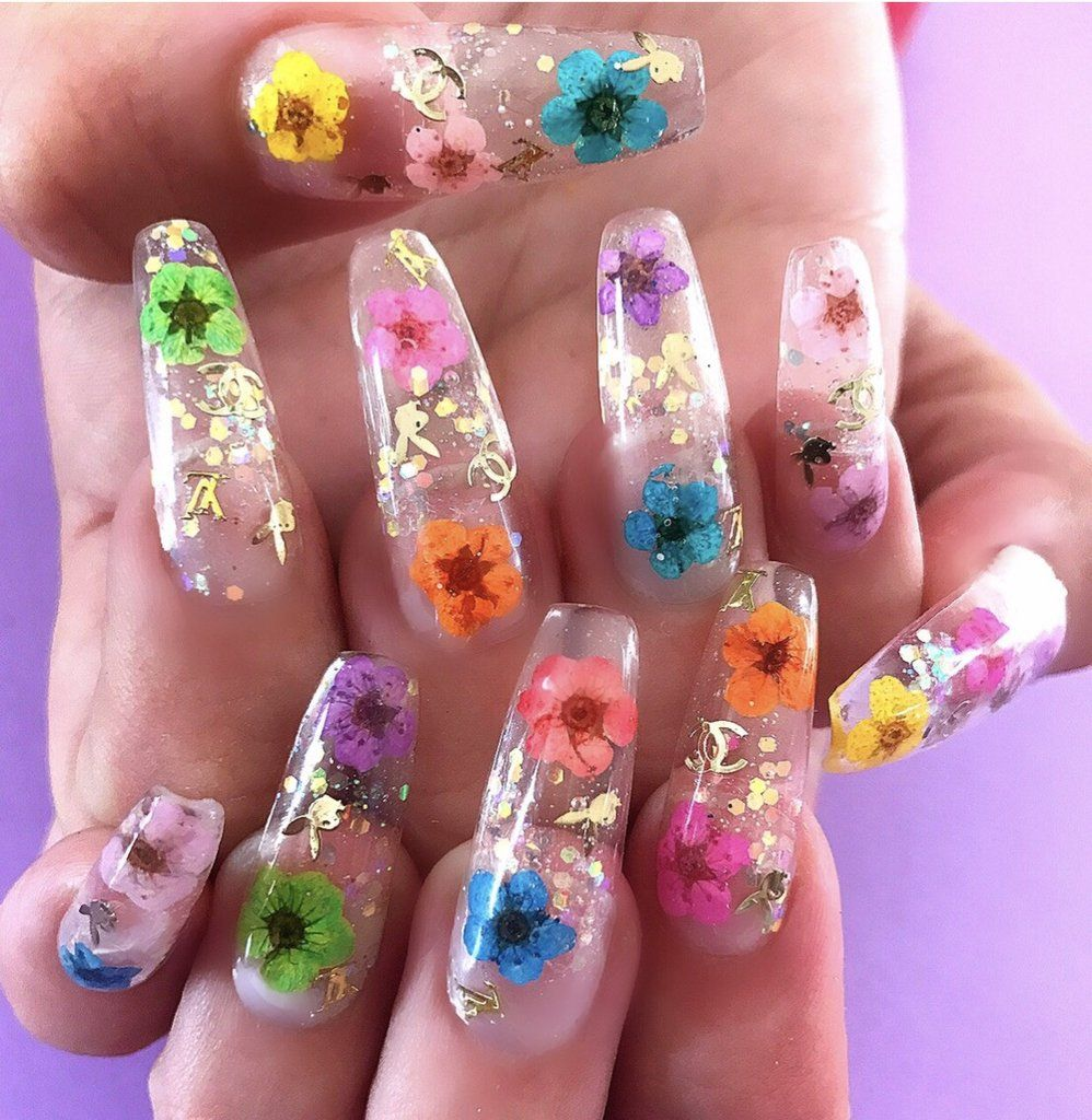Flower power talons are a clear gel nail with genuine pressed