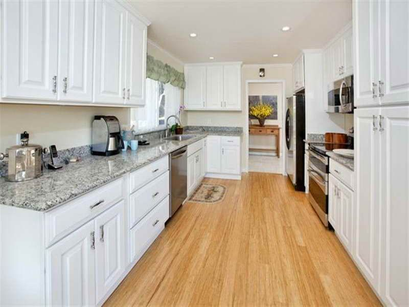 White Country Galley Kitchen light bamboo wood floors with white cabinets |  bamboo kitchen