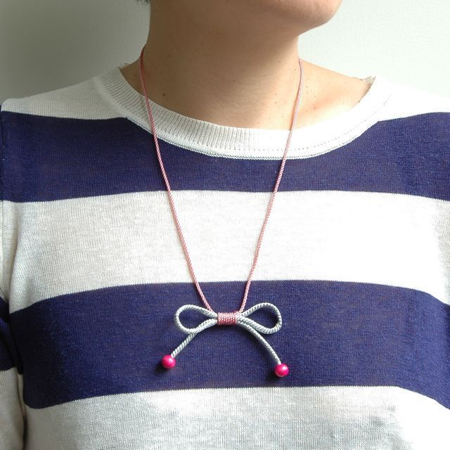Image of silver bow necklace from Hello Shiso