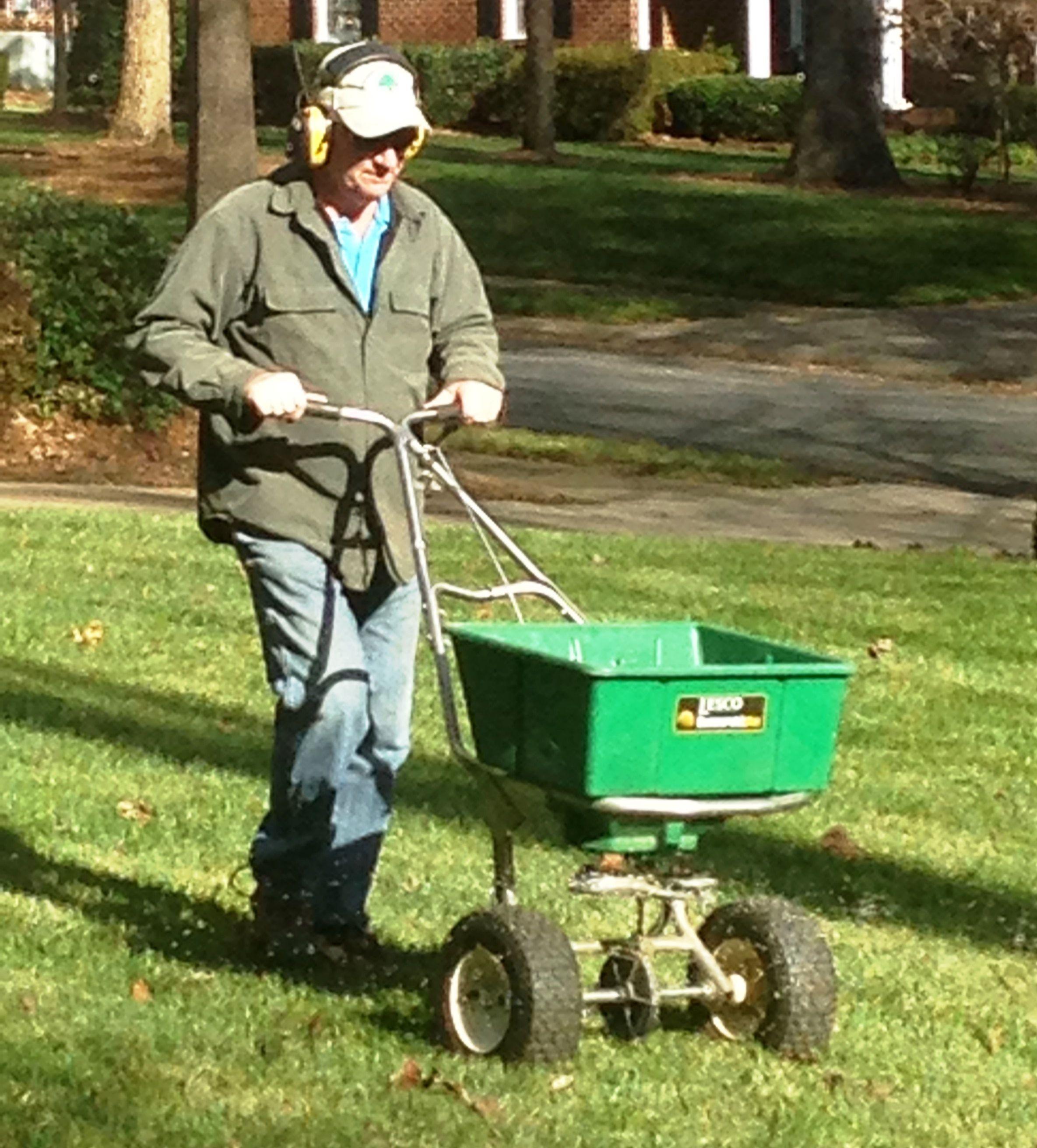 Joe Morrison, Owner and Operator of Morrison Lawn & Landscape, is applying a granular winter fertilizer on his customer lawns during December.