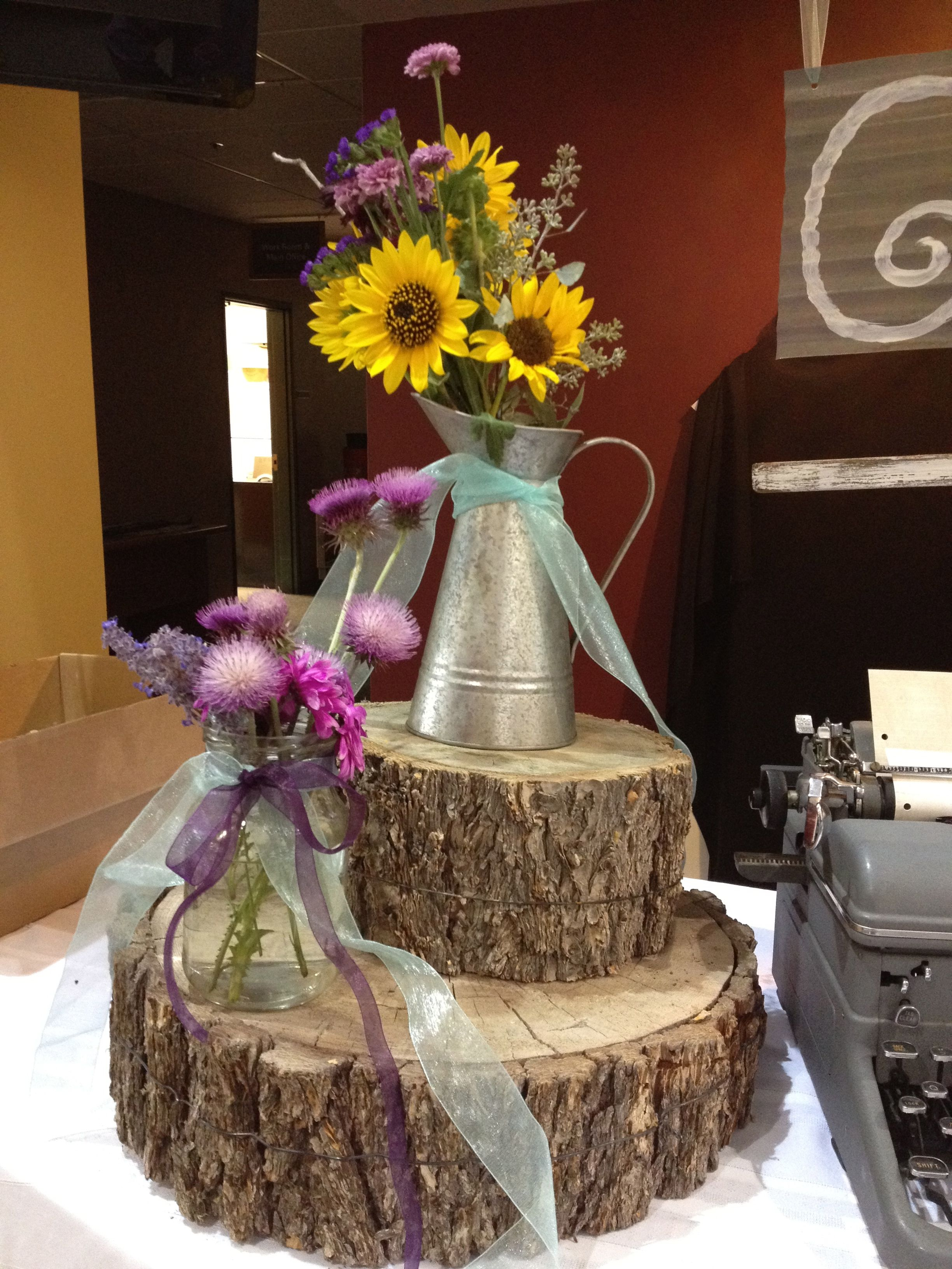 Rustic wedding reception food table decor using wood