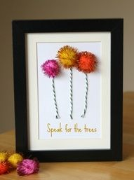 lorax art from sparkly balls... cat toys or christmas garland. Cute.