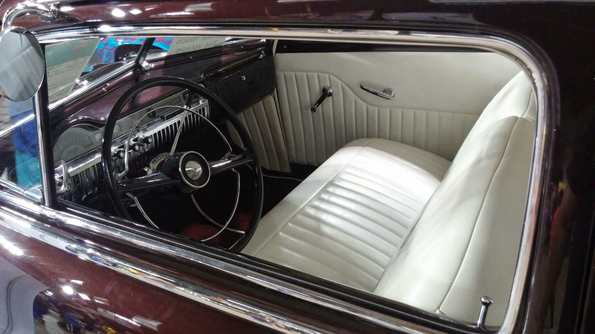 pleated white interior of a 1949 1950 Mercury coupe. Pic 1