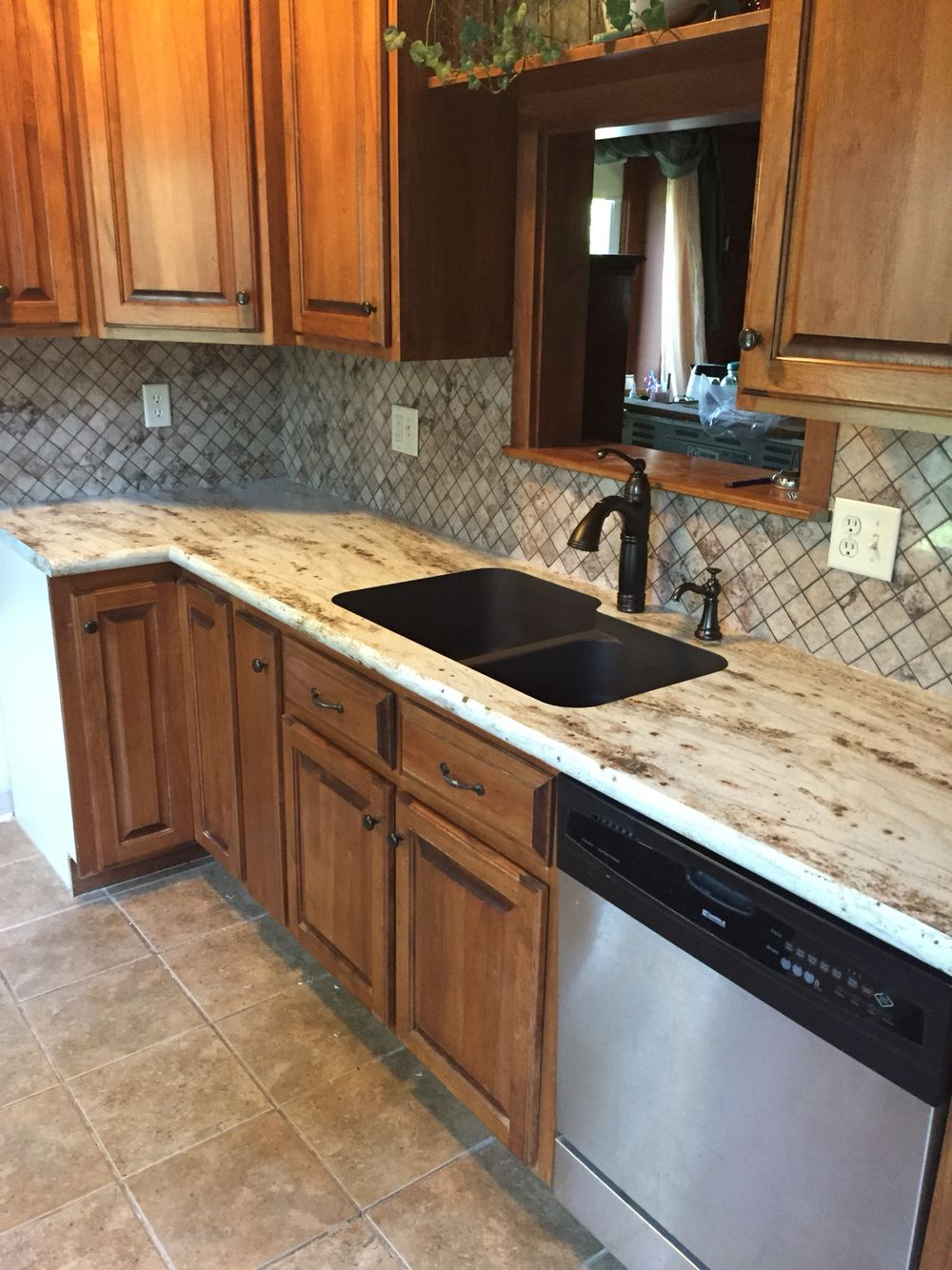 River Gold Formica Countertops With Tyvarian Tile Backsplash