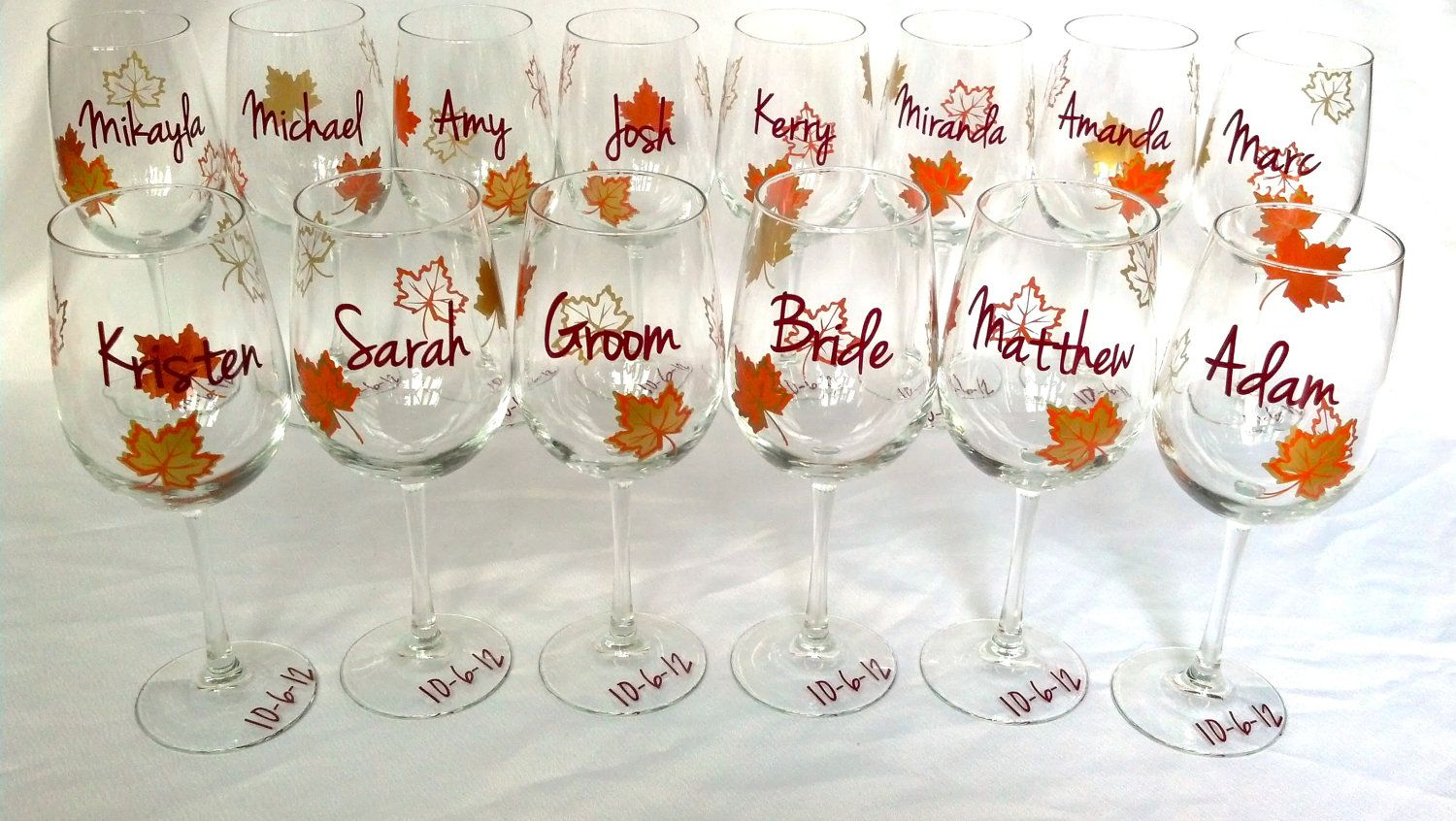 Fall wedding party wine glass, gold brown and burnt orange leaves, fall theme wine glass, Bridesmaids and Groomsman gift. $12.00, via Etsy.