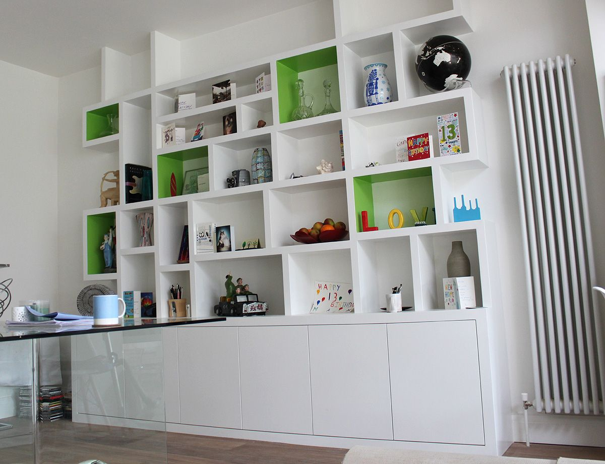 Alluring White Bookshelves Design With Impressive Shelving Like A Labyrinth Also Storages Below