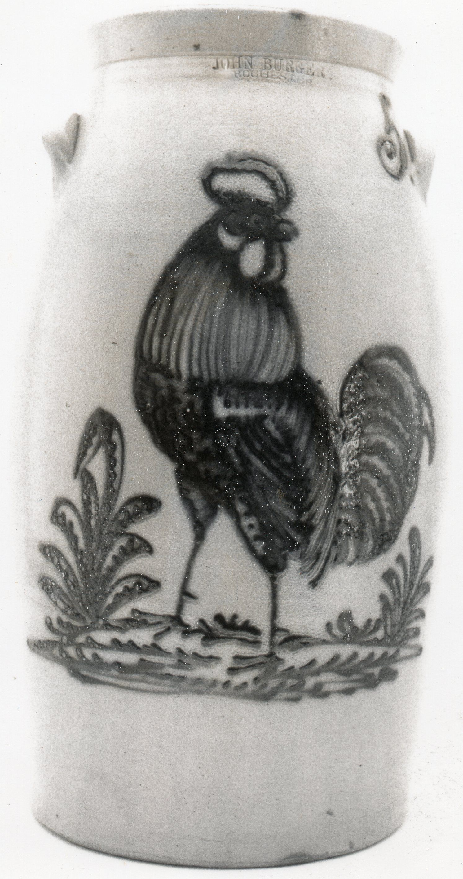 5 gal.J.Burger churn with a large highly detailed rooster on cround cover.