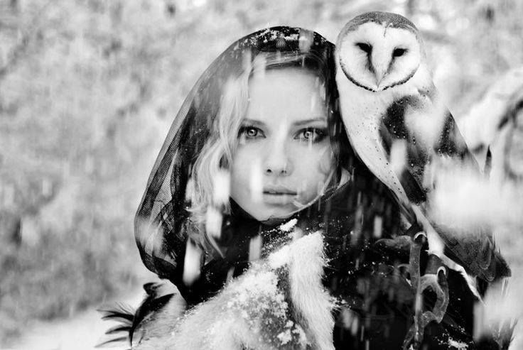 In the silent snowy winter forest... a lass ad her bird...