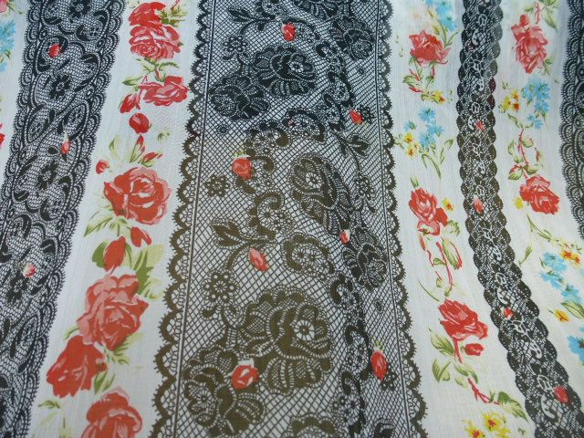 "Black lace with red, blue and yellow flowers georgette £1.00/metre 150cms or 60"", £1.00"