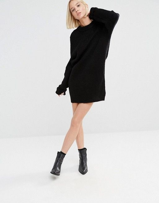 Black oversized knitted jumper dress paired with black boots