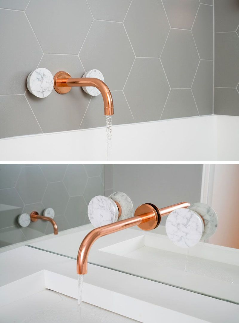 This Bathroom Features Copper and Marble Fixtures Next To Light