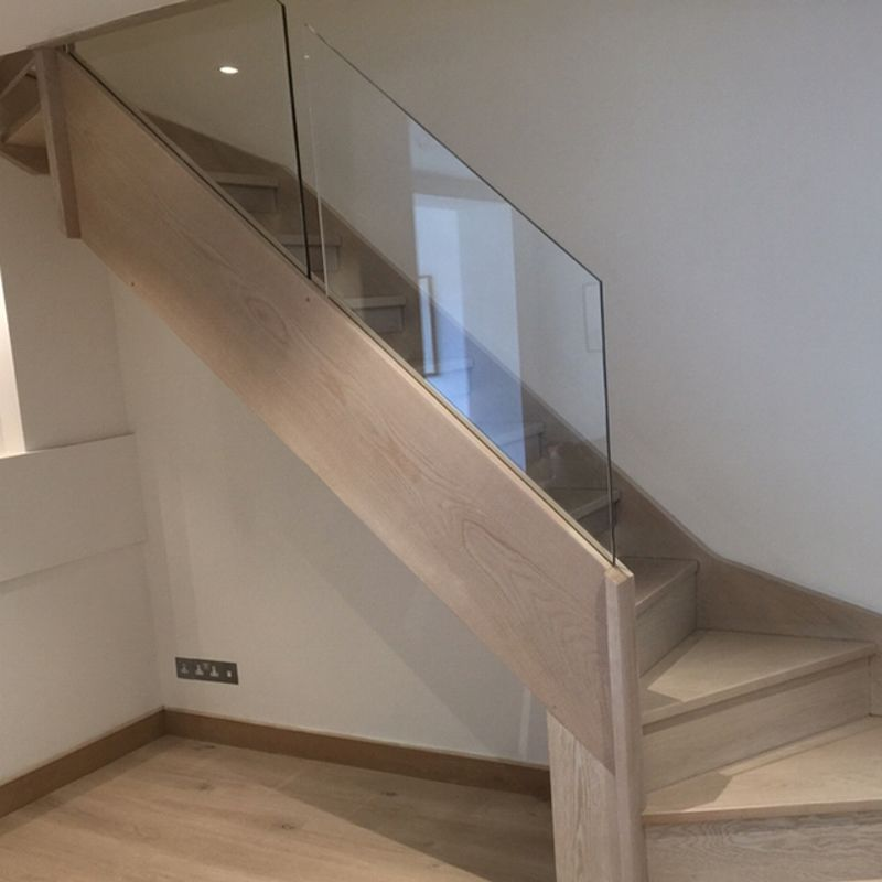 This Type Of Winder Staircase Helps Emphasize The Space In Your | Glass Staircase Near Me | Baluster | Spiral Staircase Design | Stair Treads | Frameless Glass | Staircase Railings