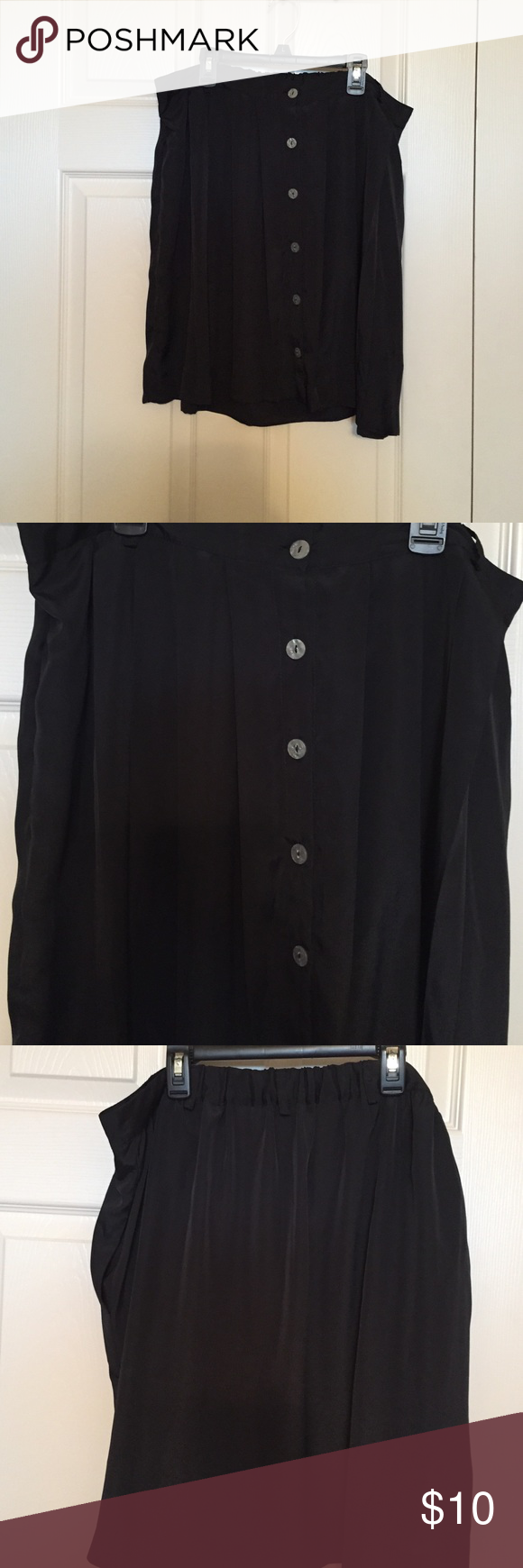 Black pleated button-down skirt with belt loops. Black pleated button-down skirt with belt loops.  From top to hem it measures 21in. Xhilaration Skirts Midi
