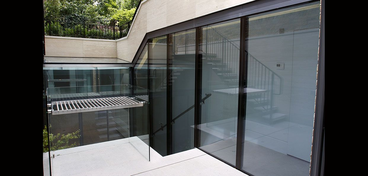 Structural Glass Wall Connection Systems : Structural glass wall lining stairwell connection to