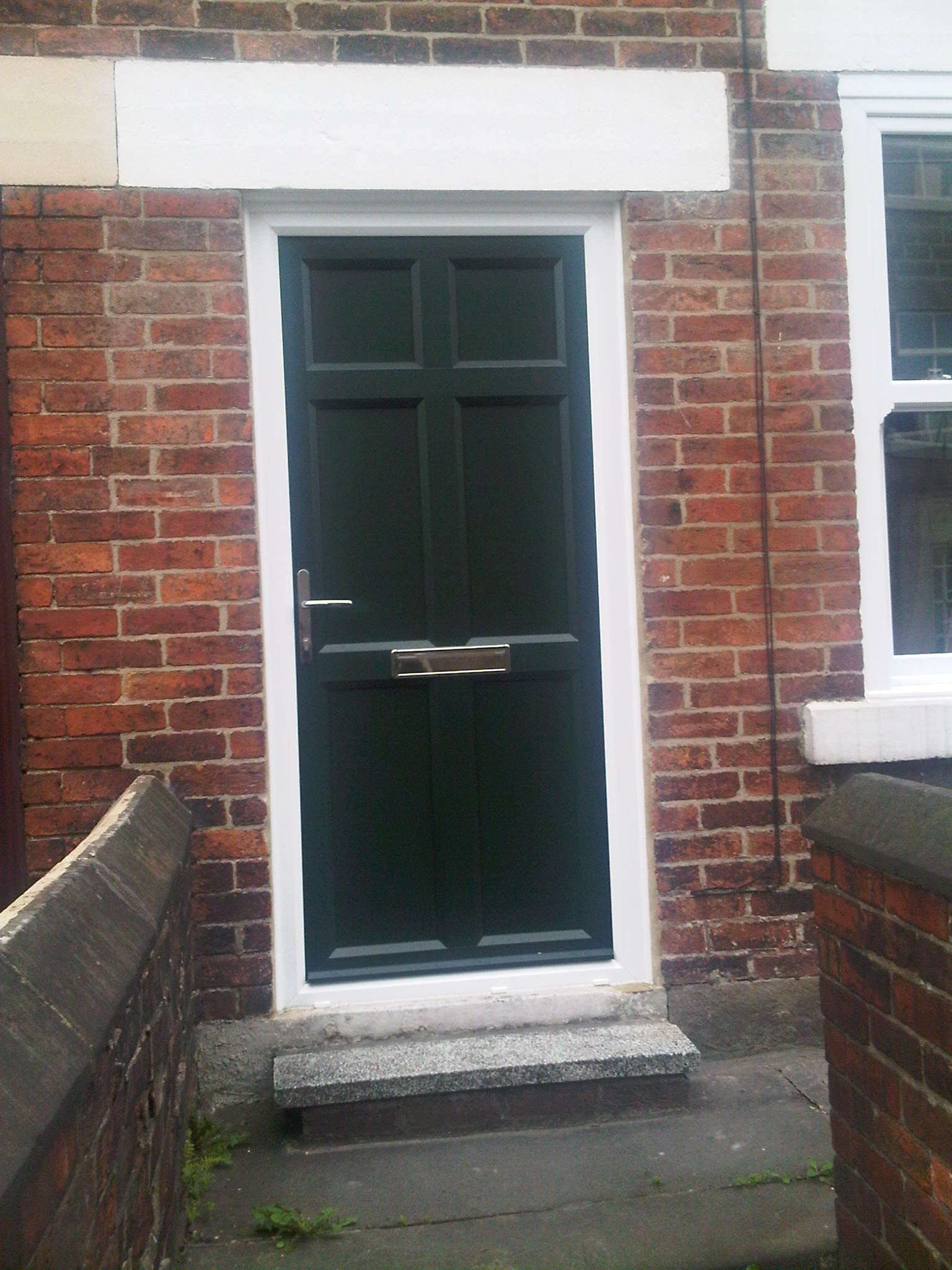 Full Panel Entrance Door In Green Upvc Making An Entrance
