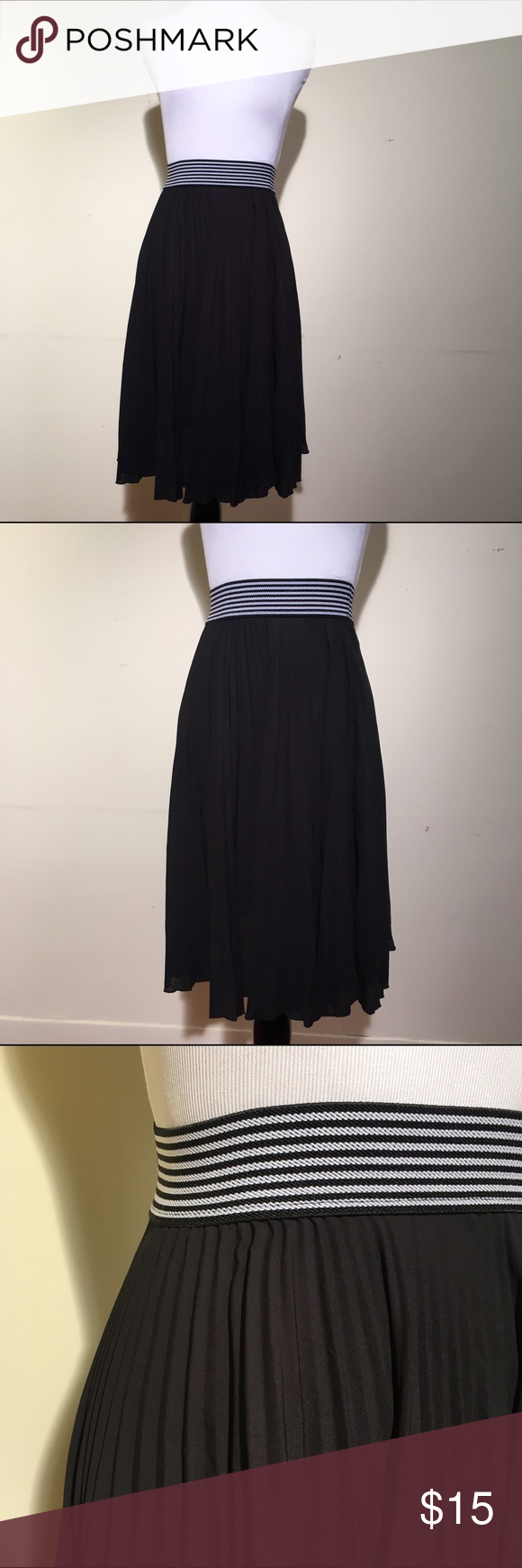 """Forever 21 black skirt. A must have staple in your closet. Striped waist band that is 20"""" total ~ very stretchable. The length is 24""""   The skirt has a slight pleated look. Forever 21 Skirts Midi"""