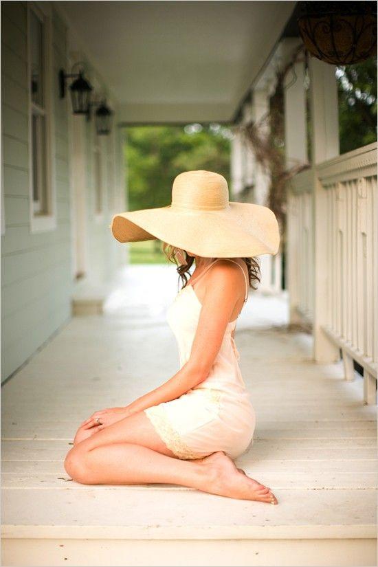 Dress, hat, porch.