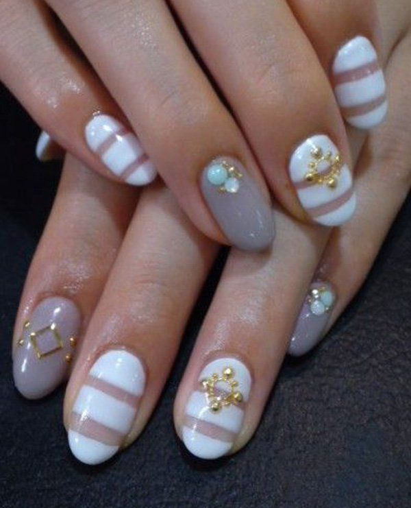 Some more options for the short nailed ladies out there. The simple white horizontal acrylic paint gives width to the nail thus removing the eye from noticing that the nail is too short for any design on it. The gold designs also help the other parts of the nails which have been coated with plain colors.