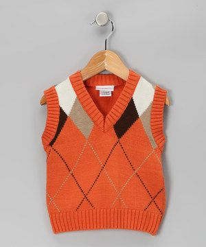 This stylish sweater vest is perfect for layering over a crisp ...