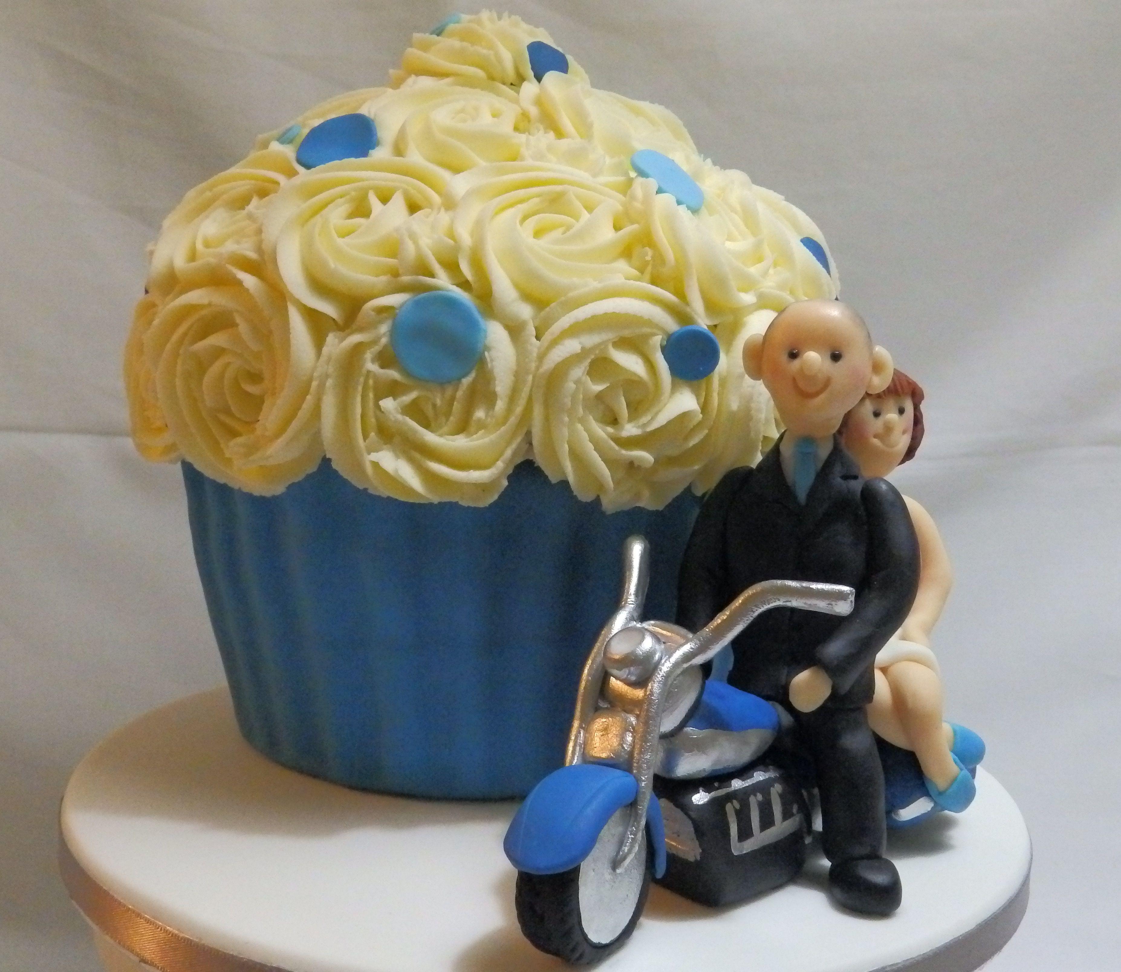 giant cupcake wedding cake with bride and groom on motorbike ...