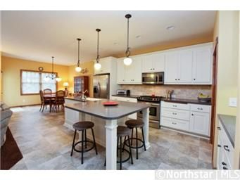 Large Kitchen with Huge Center Island, SS Appliances and White Cabinets