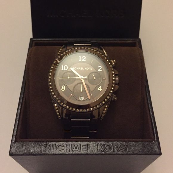 Chocolate Michael Kors watch Great condition, barely worn. No scratches or scuffs. Brand new battery. Michael Kors Jewelry Bracelets