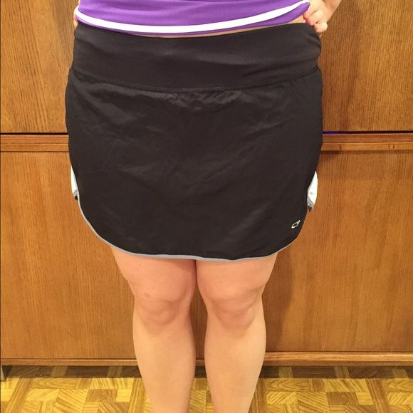 Champion Skort  Workout skort, in good condition. Super tiny hole right near front logo hardly noticeable! 100% polyester Champion Shorts Skorts