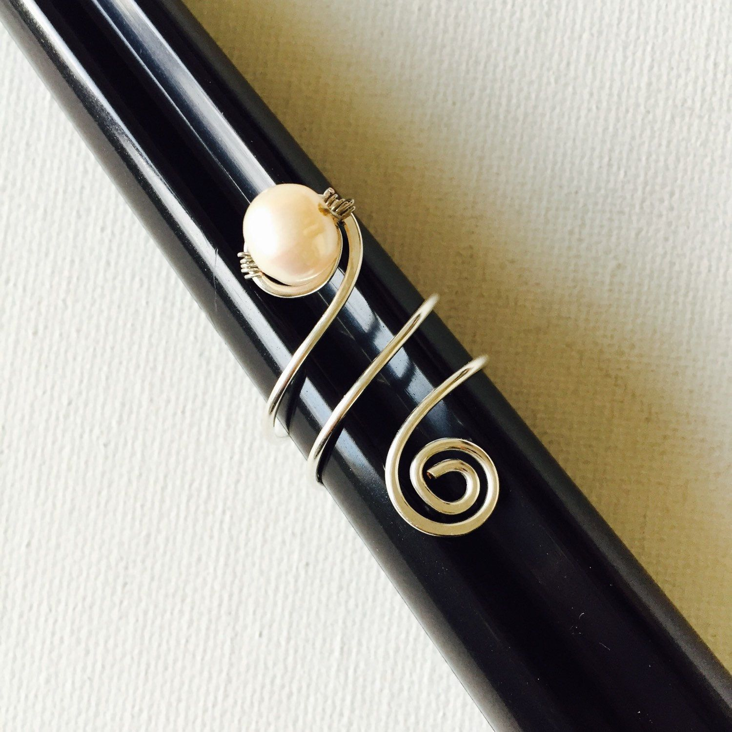 Made a silver adjustable wire pearl ring!