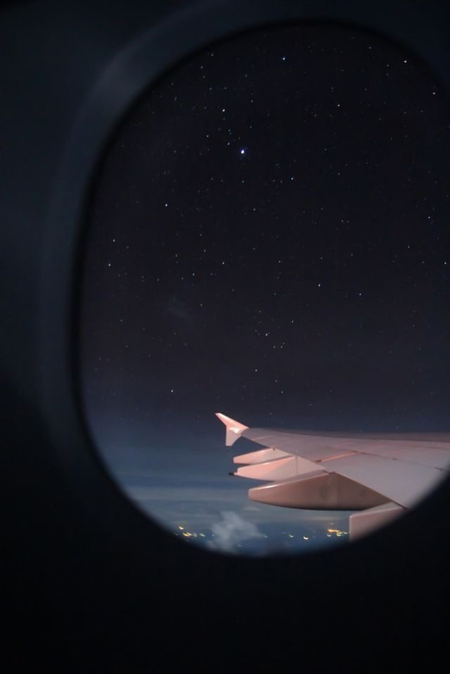 Night in the sky .  Enjoy the Little Things in Life . Airplane .