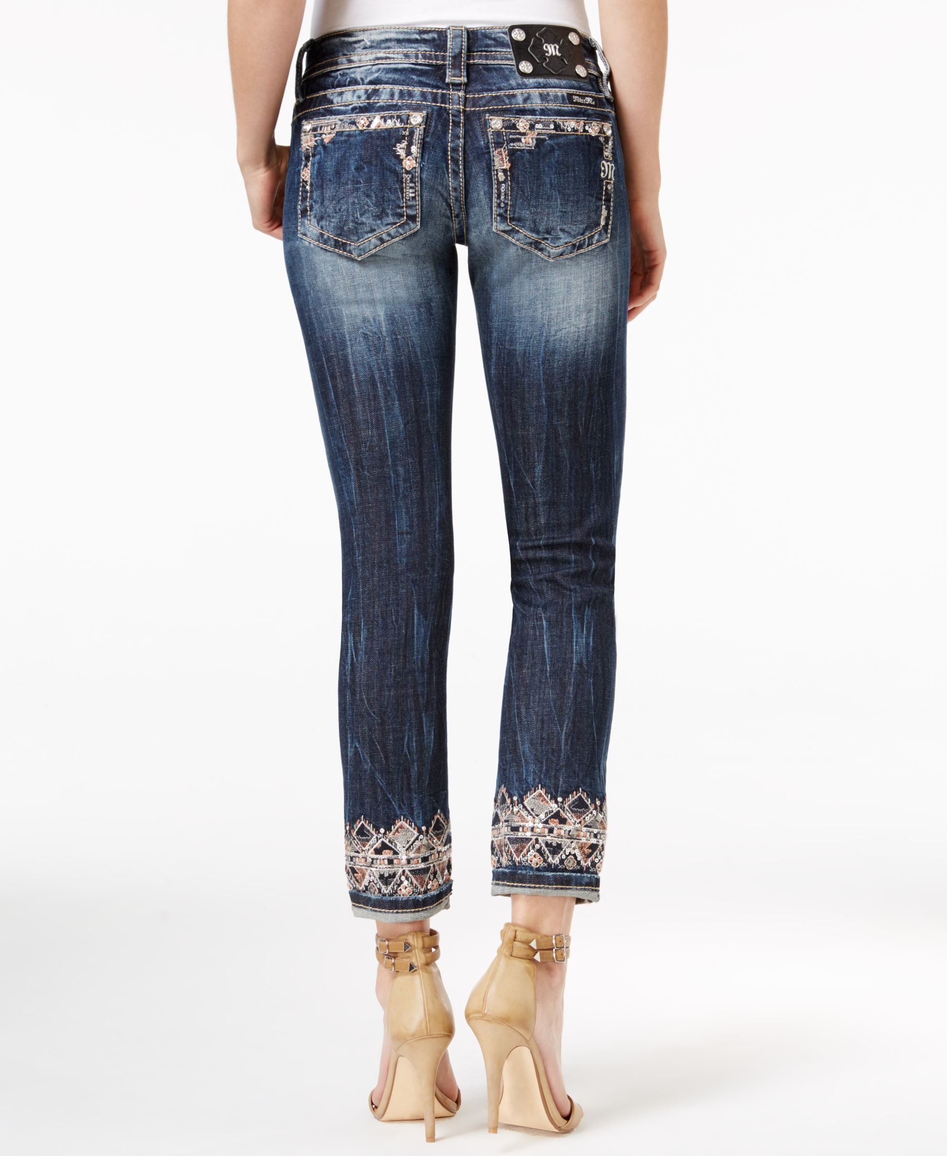 Embroidery adds intricate and unexpected details to Miss Me's cropped jeans, making them the star of any ensemble. | Cotton/spandex | Machine washable | Imported | Mid rise | Slim fit through hips and