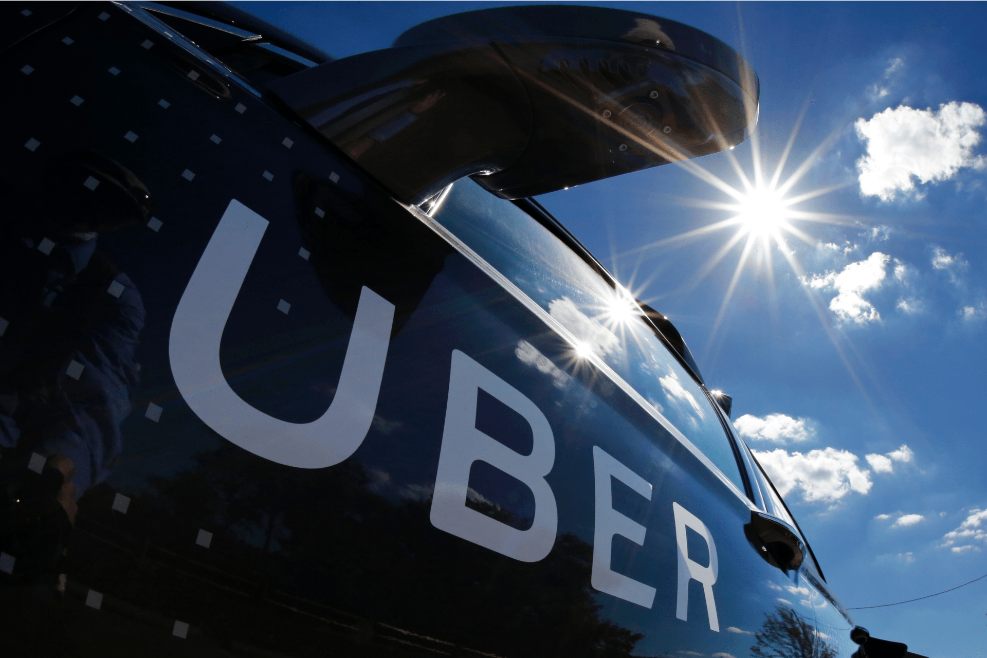 Uber trial on trade secrets delayed as federal probe