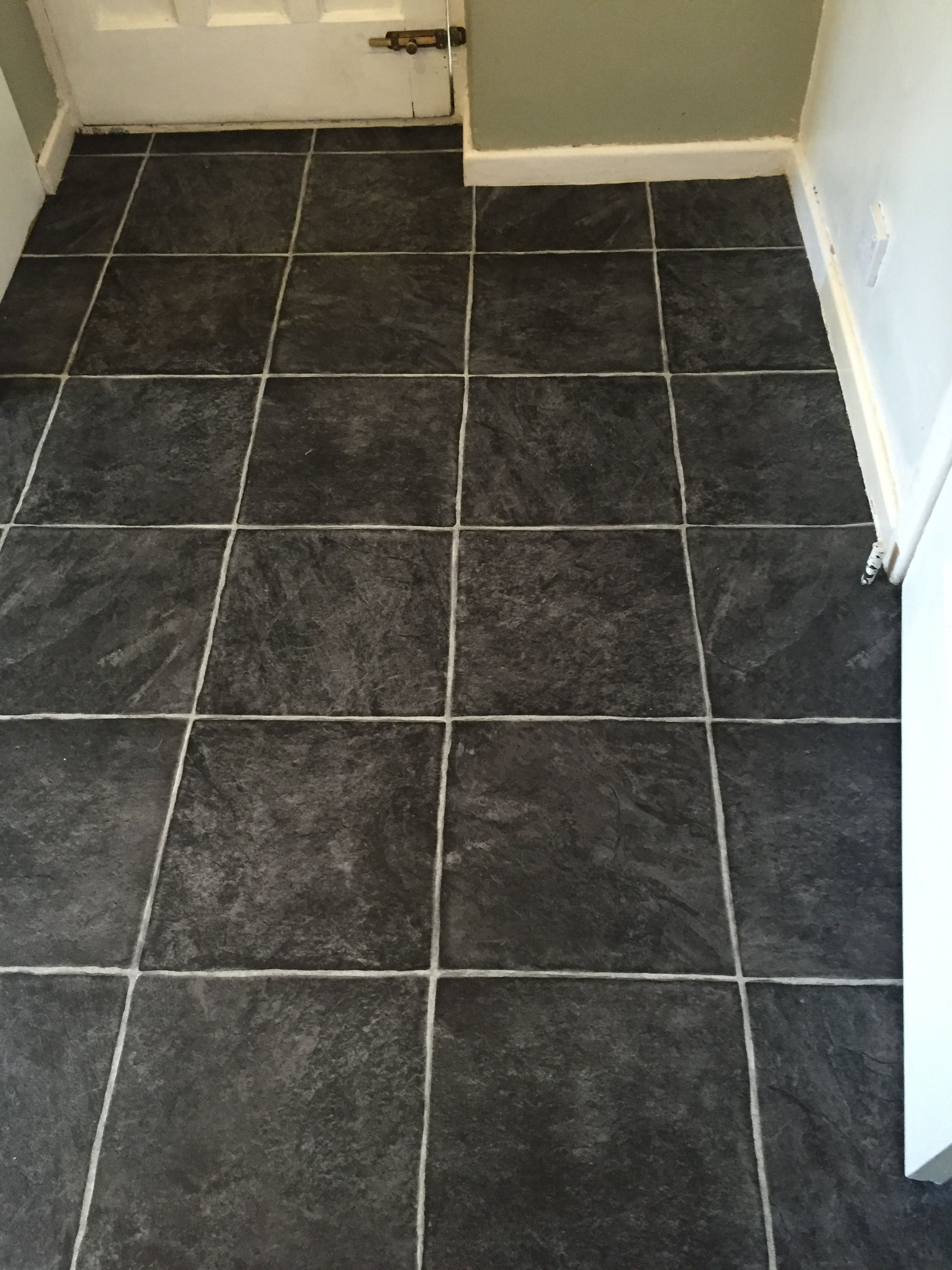 Grey Tile Effect Laminate Flooring Fitted In A Hallway In Stockport
