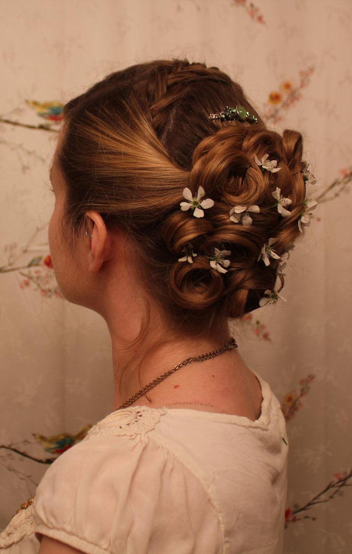 love the cute bun with little flowers great for a wedding!   Hair styles, Hairdo, Hair beauty