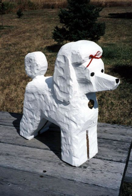 {carved wooden poodle from the Dog Bark Park people in Cottonwood, in black please and if you want I will take both poses}