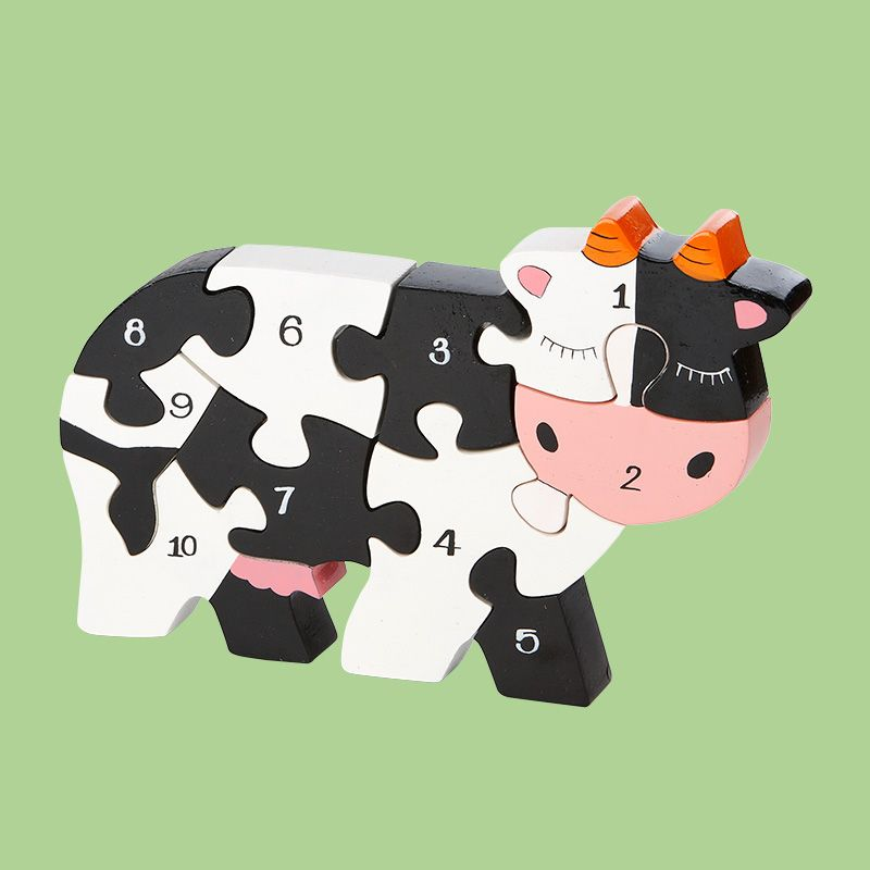 Cow – Number Jigsaw (600250) Gorgeous, educational jigsaw puzzle. Handpainted in bright, non-toxic colours. When not being played with they look great displayed on a shelf. www.kawaiianimals.com