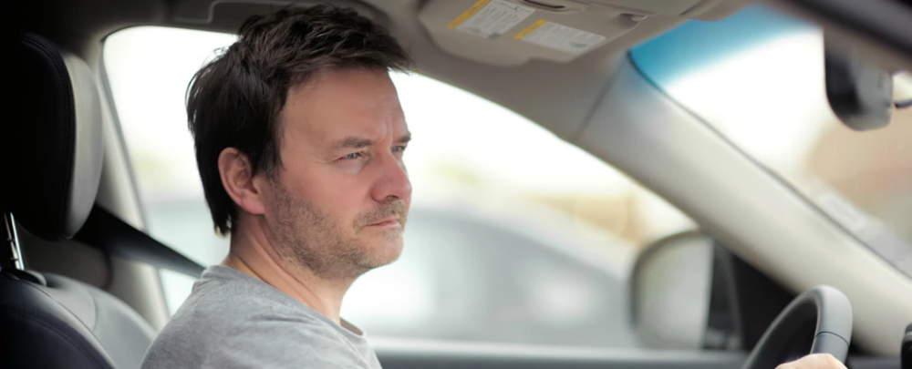 Man Sits In His Car Wondering How To Get Out Of His Upside Down Car Loan In 2021 Car Loans Owe Money Sell Car