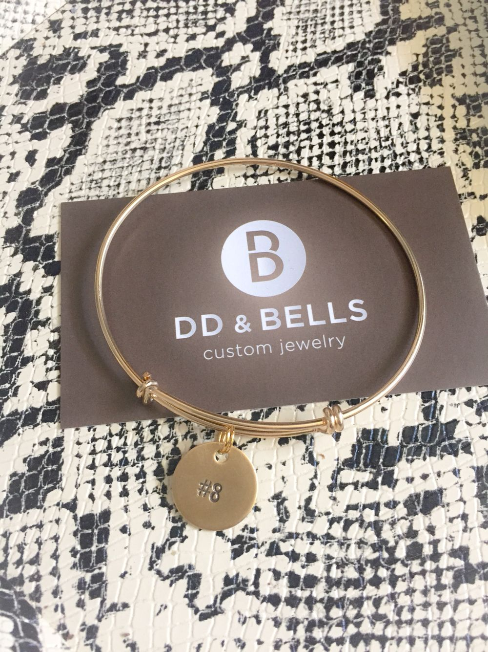 A new twist to D&B's custom bracelets: 14k gold filled bangle with personalized son's sports number. Thanks @kkwilder5! #ddandbells