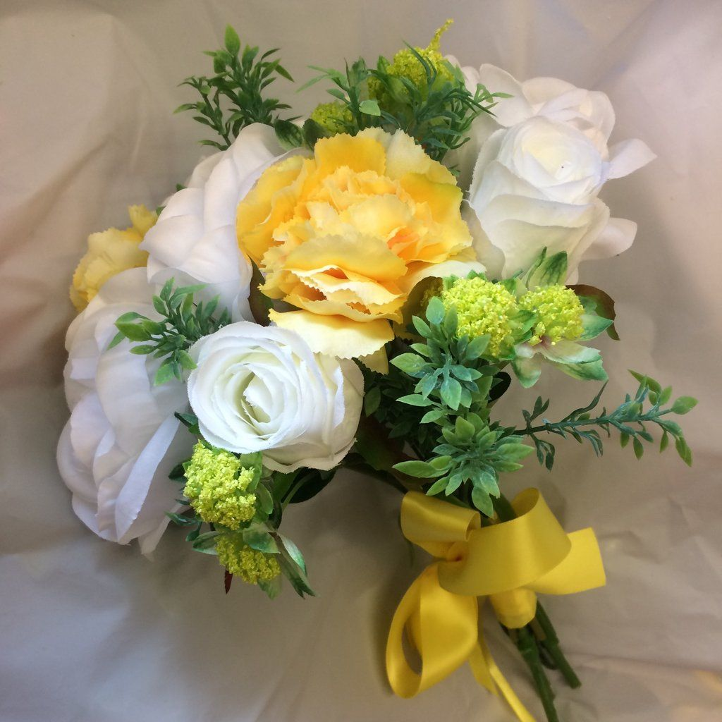 A Bridesmaid Posy Of Yellow And White Artificial Flowers