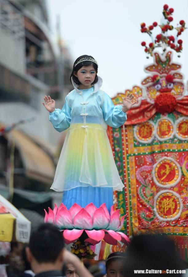 Performers Walk In The Parade Crowd During The Cheung Chau Bun