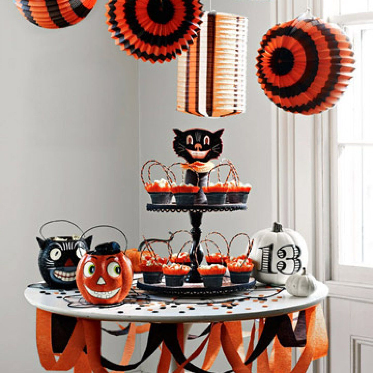 Black cats, lucky numbers and delicious sweets set a festive scene - Diy Indoor Halloween Decorations