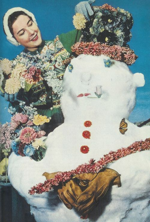 Utah, 1958  Woman decorates a snowman with preserved flowers that are up to three years old. Flowers retain their original shape, colour and size after they'd been buried in sand for two weeks.