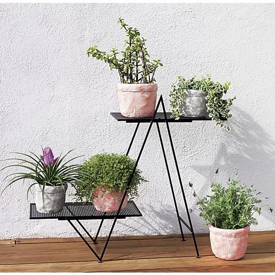 Above: With A Black Matte Frame And Two Mesh Shelves, An Angled Plant Stand