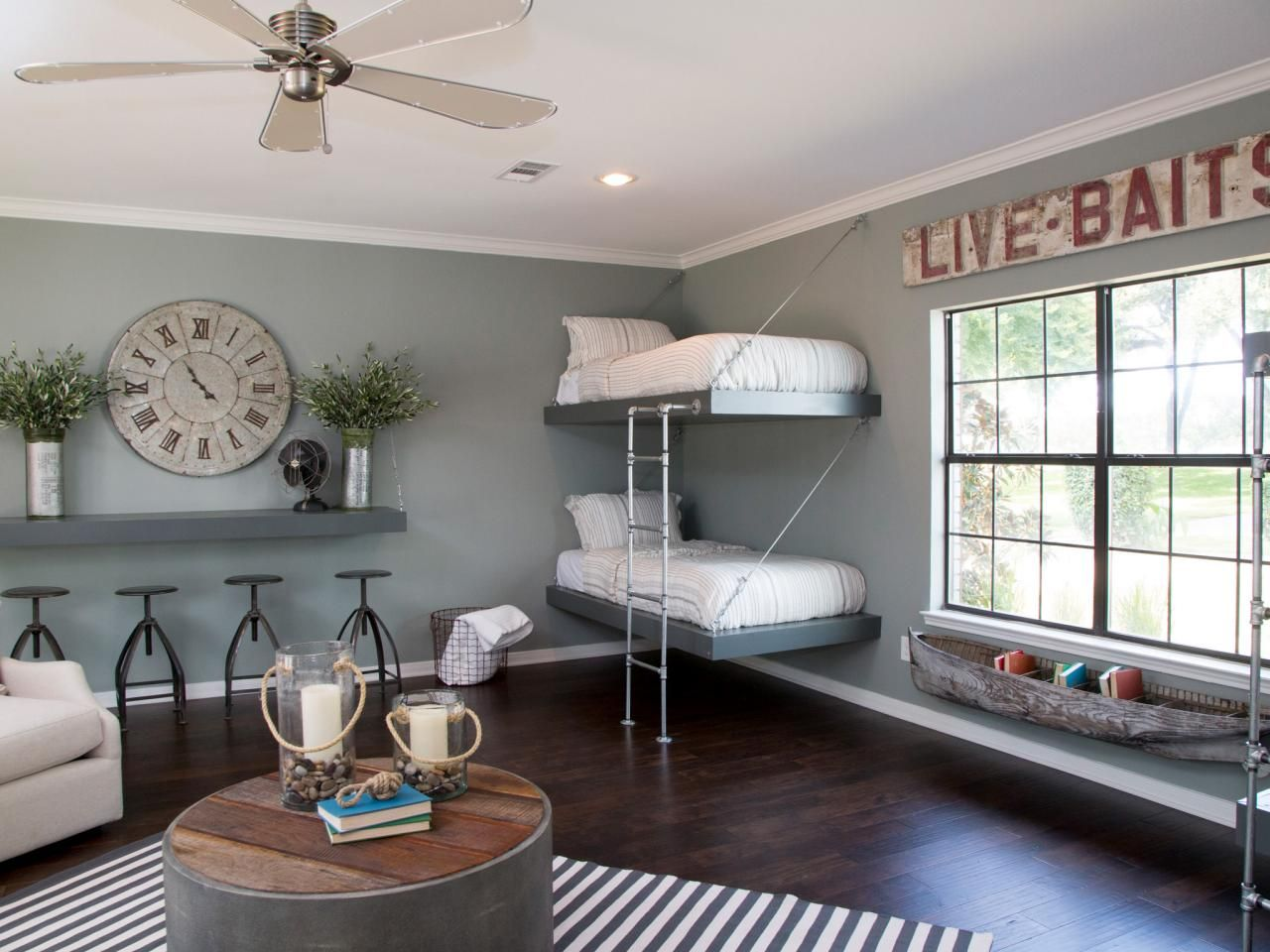 Multi Purpose Guest Bedroom Blue Grey Walls Dark Wood Floors And Distinctive Furnishings All