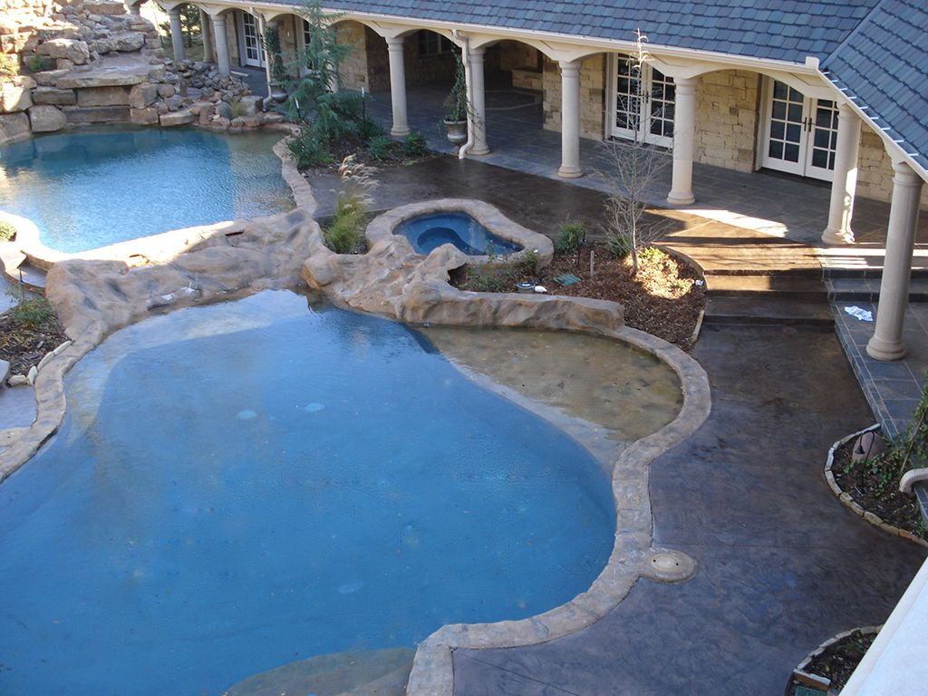 Stamped Concrete around the pool Work done by Advanced Concrete