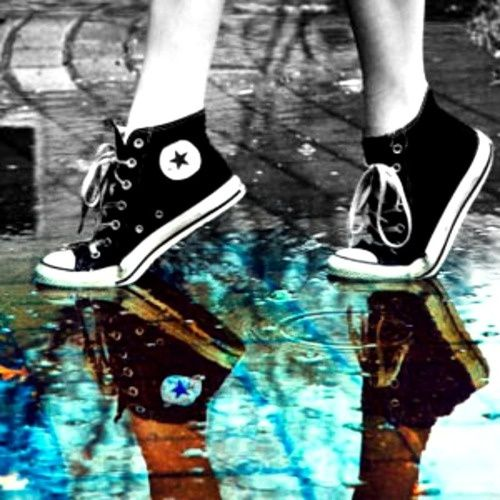 Black all star chucks converse reflection in a rain puddle