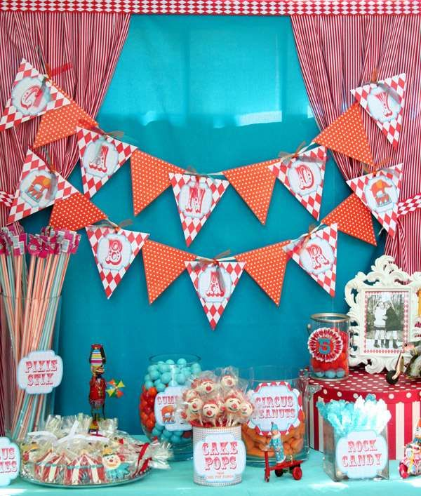 Circus Party - another red and aqua instpiration.  I like using a plastic tablecloth as a backdrop and also like the bunting.  (Which I did last year and is not that hard to make)