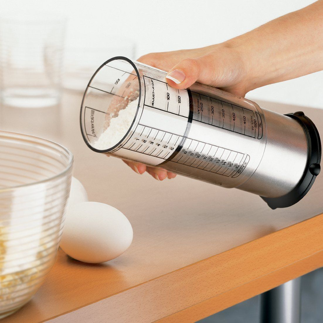 Adjustable Measuring Cup Holds Up To 2 Cups Of Dry Or