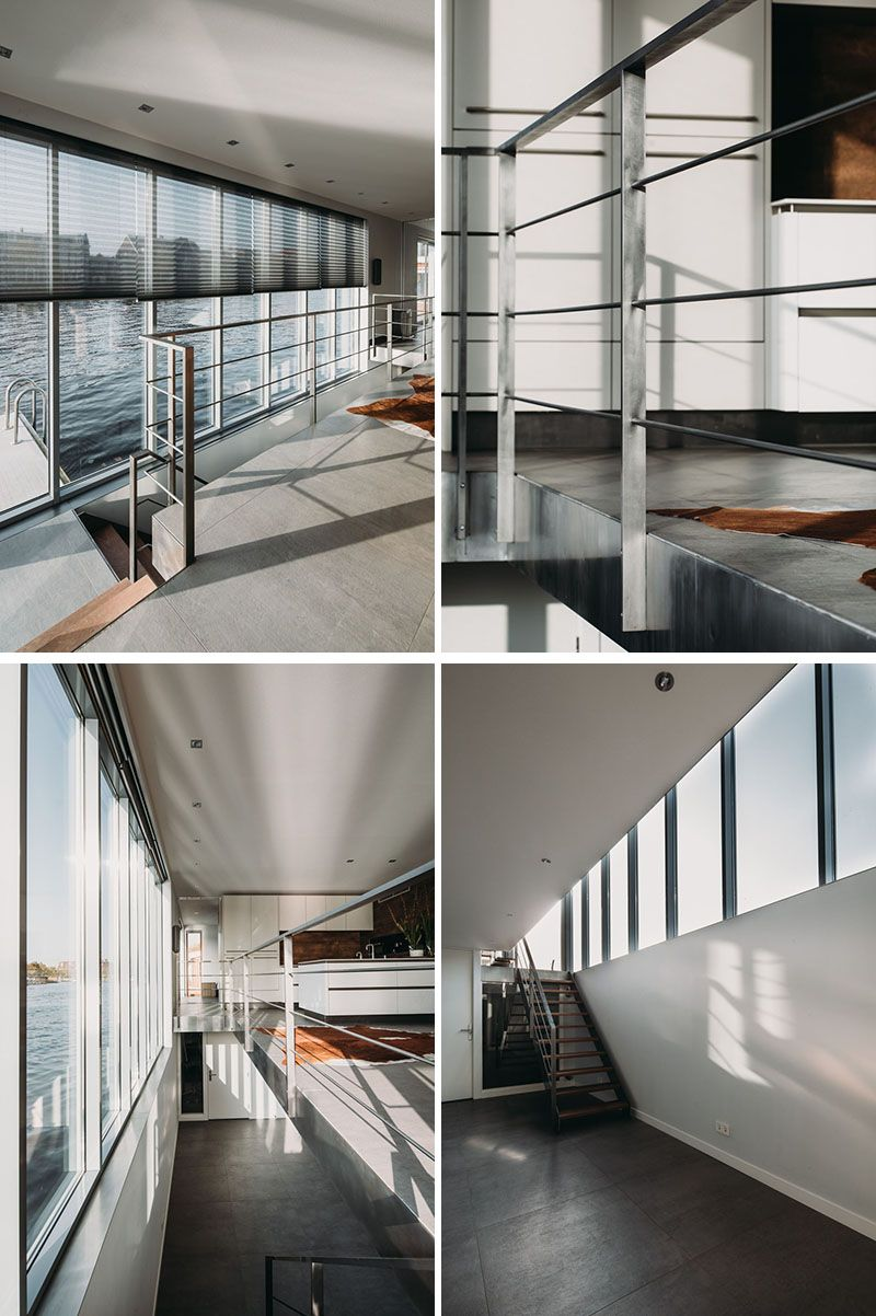 This modern houseboat has a staircase that leads down to the lower level with open space and a couple of bedrooms stairs handrail